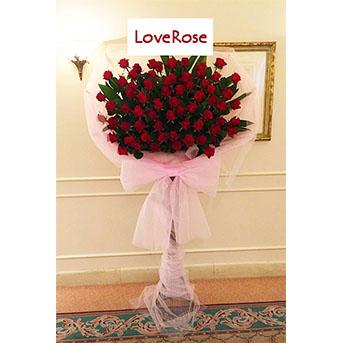 [屋内専用]赤バラの豪華な花束風スタンド花