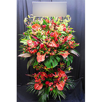 グロリオサとアンスリュームのスタンド花