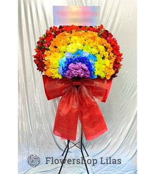 虹をイメージしたスタンド花